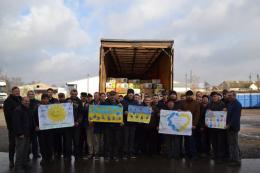 Підприємці Хотинського району відправили солдатам на фронт 20 тон яблук