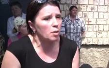 У Чернівцях жінку з двома дітьми виганяють на вулицю. Сусіди протестують (+3 відео)